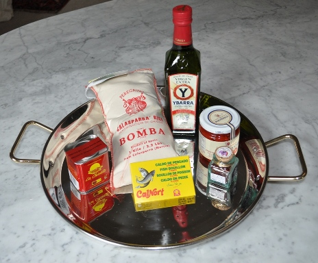Spanish paella pan with contents of paella kit